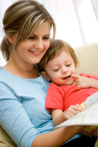 Mother and 20 months old child reading picture book